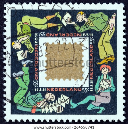 """NETHERLANDS - CIRCA 1991: A stamp printed in the Netherlands from the """"Christmas """" issue shows Greetings Cards keep People in Touch, circa 1991. - stock photo"""