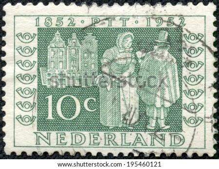 "NETHERLANDS - CIRCA 1952: A stamp printed in the Netherlands from the ""Netherlands Stamp Centenary and Centenary of Telegraph Service"" issue shows Postman delivering letters, 1852, circa 1952."