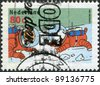 """NETHERLANDS - CIRCA 1999: A stamp printed in the Netherlands, shows an illustration of the book """"Explorers on the Moon"""" by Georges Prosper Remi, Tintin, Snowy in space suits, circa 1999 - stock photo"""