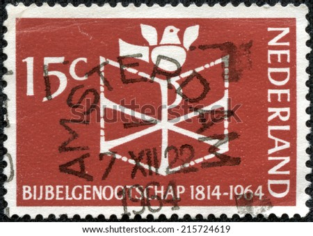NETHERLANDS - CIRCA 1964: a stamp printed in the Netherlands shows Bible, Chrismon and Dove, 150th Anniversary of the Founding of the Netherlands Bible Society, circa 1964 - stock photo