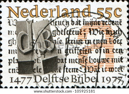 NETHERLANDS - CIRCA 1977: A stamp printed in the Netherlands shows Delft's Bible, circa 1977 - stock photo