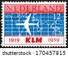 NETHERLANDS - CIRCA 1959: a stamp printed in the Netherlands shows Douglas DC-8 and World Map, 40th Anniversary of the Founding of KLM, Royal Dutch Airlines, circa 1959 - stock photo