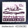 NETHERLANDS - CIRCA 1914: A stamp printed in the Netherlands shows image of a shipyard, series, circa 1914 - stock photo