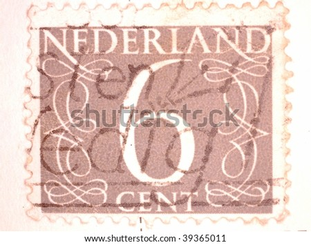 "NETHERLANDS - CIRCA 1935: A stamp printed in the Netherlands shows image of the number ""6"" surrounded with decorative swirls, series, circa 1935"