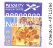 "NETHERLANDS - CIRCA 2003: A stamp printed in the Netherlands shows image of Van Gogh's Sunflowers and ""priority"", series, circa 2003 - stock photo"