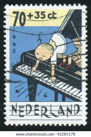 NETHERLANDS - CIRCA 1992: Children Making Music, circa 1992.