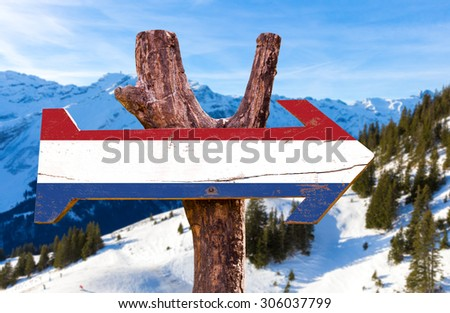 Netherlands Flag wooden sign with winter background - stock photo