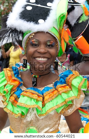 NETHERLANDS - JULY 31: Unidentified woman in the Summer Carnival parade on July 31, 2010 in Rotterdam, The Netherlands. This parade is organized every year and attracts 800.000 visitors.