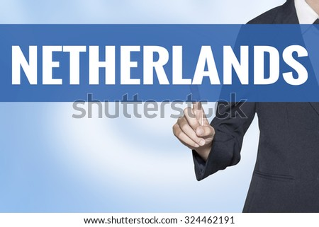 Netherlands word on virtual screen touch by business woman blue background - stock photo