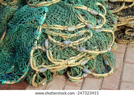 Nets and lead weights, closeup of photo - stock photo