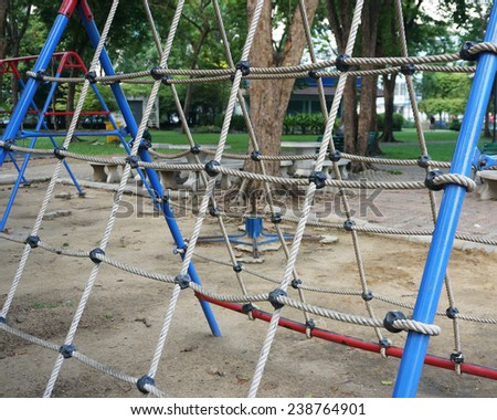 Netting for climbing with a thick rope for children climb on the playground.                                 - stock photo