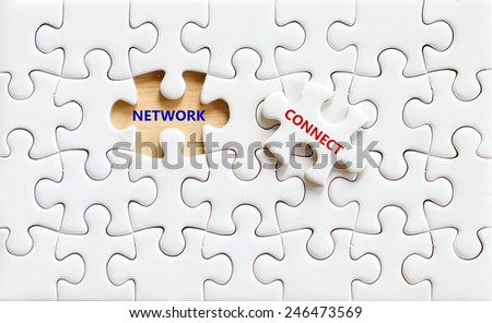 Network and connect word on white puzzle piece, social media and business concept background - stock photo