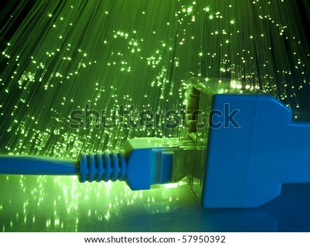 network cable and hub closeup with fiber optical background - stock photo