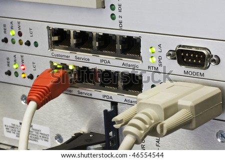 network cable connected to telephone centre - stock photo