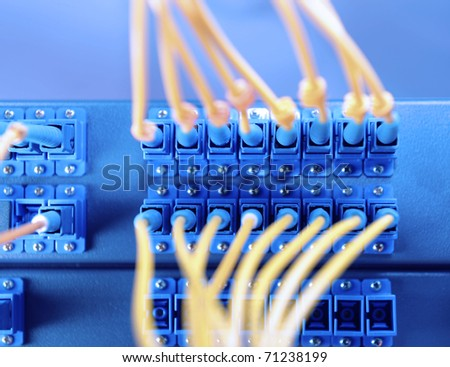 network cables and hub in data center - stock photo