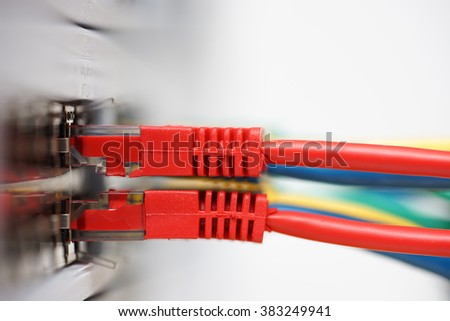 network cables connected in network switch with blank space,side view - stock photo