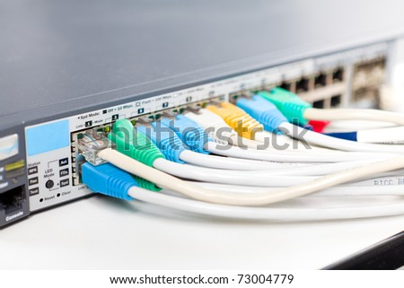 Network cables connected into router - stock photo