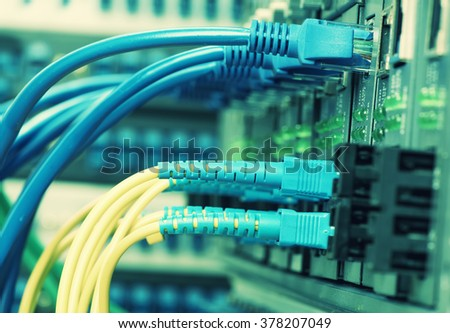 Network cables connected to ethernet ports - stock photo