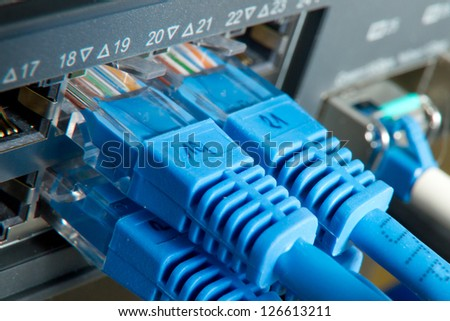 network cables connected to hub - stock photo