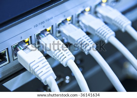 network cables RJ45 connected to a switch - stock photo