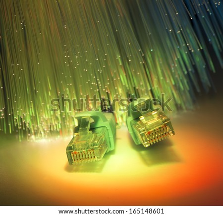 network data cables and hub closeup with fiber optical background - stock photo