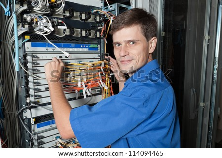 Network engineer in server room