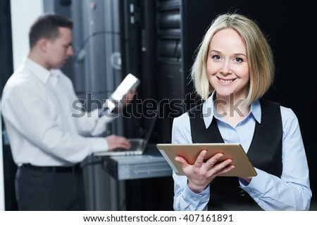 network female service engineer in server room - stock photo