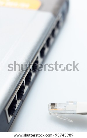 network hub switch with lan cable disconnected over white - stock photo