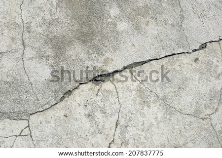 Network of cracks on a concrete wall