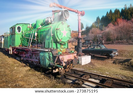 Network of narrow-gauge railway was built in the Carpathian region in the late XIX century. In Kolochava on the tracks should train consisting of a locomotive and ten passenger and freight cars.  - stock photo