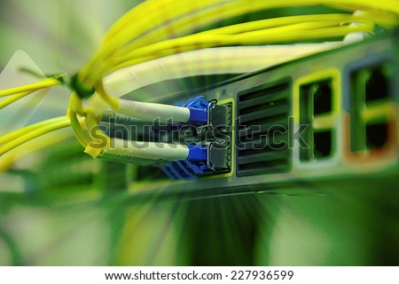 network optical fiber cables and hub - stock photo