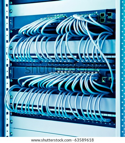 network rack with cables switches and patch - stock photo