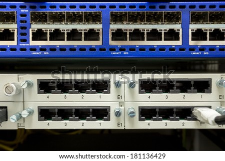 Network RJ-45 switch in technology center - stock photo