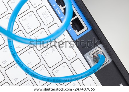 Network router and keyboard - stock photo