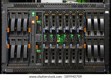 Network Server Rack Panel with hard disks in a data center. - stock photo