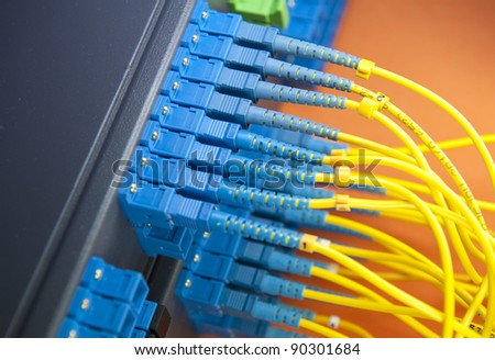 network server room with fiber optic hub for digital communications and internet - stock photo