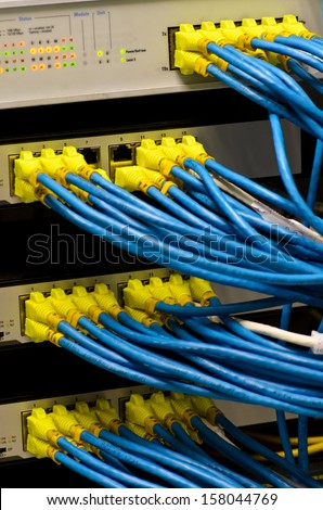 Network switch and UTP ethernet cables - stock photo