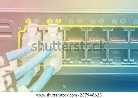 Network switch and UTP ethernet cables in data center - stock photo