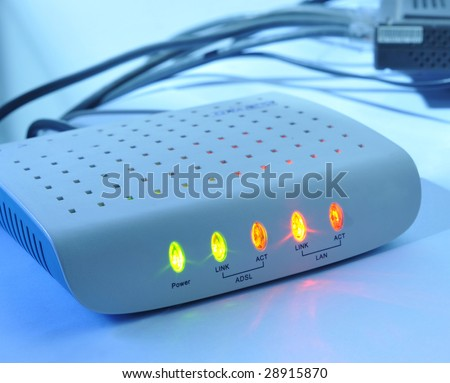Networking and security concepts. Wireless ADSL router on a white background. - stock photo