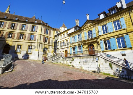 NEUCHATEL, SWITZERLAND - SEPTEMBER 09, 2015: Urban scene of architecture, view of historical buildings in the city with a population of approx. 34000 mainly French-speaking residents - stock photo