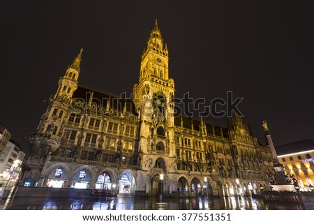 Neues Rathaus (The New Town Hall) on a rainy night, Munich, Germany - 31 Jan 2016: It was built between 1867 and 1908 by Georg von Hauberrisser in a Gothic Revival architecture style.