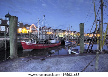 NEUHARLINGERSIEL, GERMANY - MAY 29: trawlerS in the harbor of neuharlingersiel, germany , Neuharlingersiel Harbor May 29, 2013 in Neuharlingersiel, Germany - stock photo