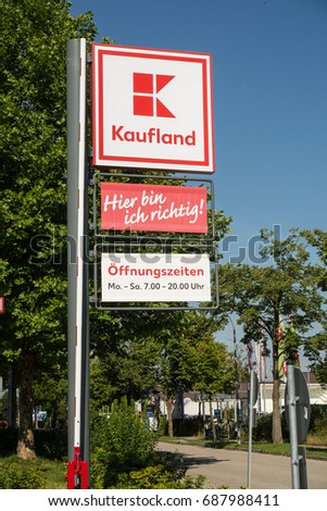 Neuoetting,Germany-August 01,2017: Sign at the entrance to a Kaufmakrt supermarket,with opening hours and store slogan