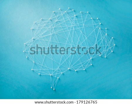 Neural network created by pins and threads - stock photo