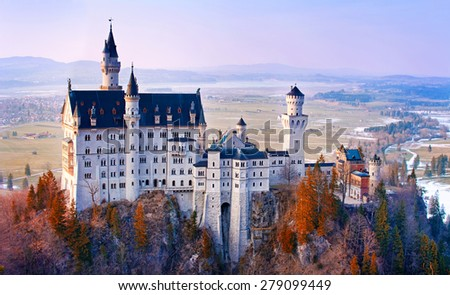 Neuschwanstein, beautiful fairytale castle near Munich in Bavaria, Germany, with colorful trees. - stock photo