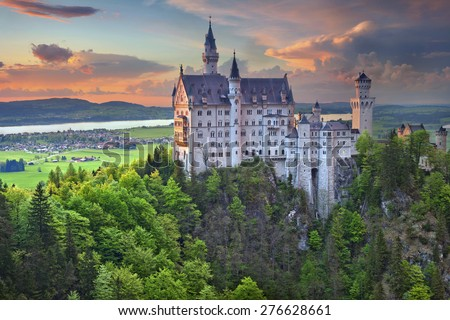 Neuschwanstein Castle, Germany. Neuschwanstein Castle is a nineteenth-century Romanesque Revival palace on a rugged hill above the village of Hohenschwangau near in southwest Bavaria, Germany.  - stock photo