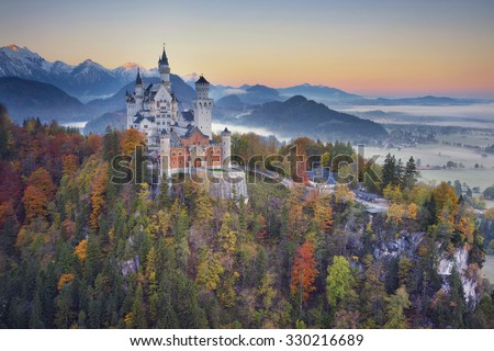 Neuschwanstein Castle, Germany. View of Neuschwanstein Castle during foggy autumn twilight. - stock photo