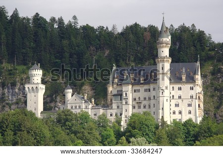 Neuschwanstein Castle in Bavaria, with surrounding woods. - stock photo