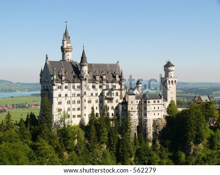 """Neuschwanstein Castle in Germany, built by/for """"crazy"""" King Ludwig II, which inspired the 'Sleeping Beauty' image of castles. It was Walt Disney's inspiration for Cinderella's castle - stock photo"""