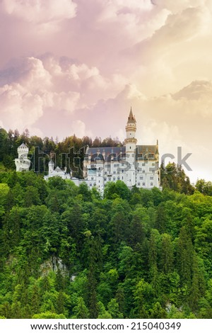 Neuschwanstein castle in the forests of Bavaria, Germany - stock photo